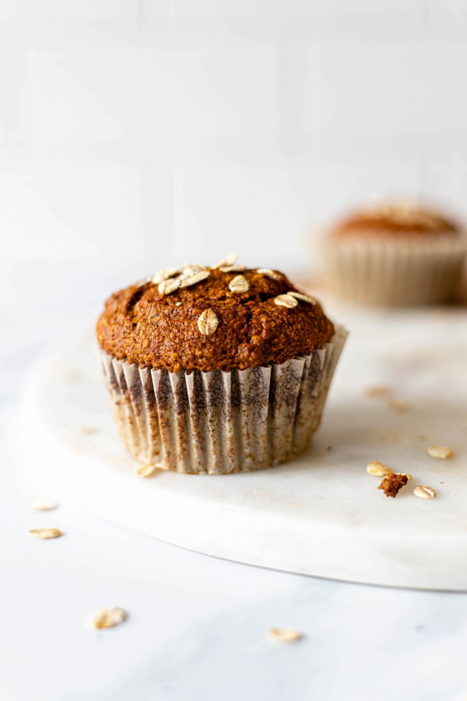 single vegan muffin with oats on top