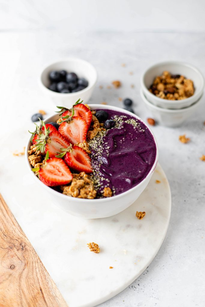 smoothie in a bowl with granola and fruit